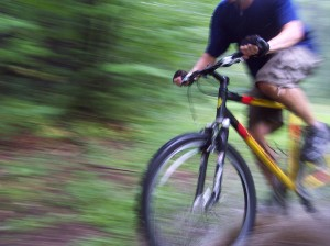 bigstock_Biking_Through_The_Forest_260771